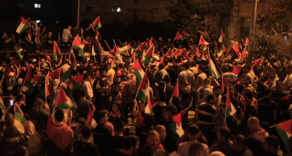 More than 10,000 Palestinians marched in protest against Israel's military actions in the Gaza Strip. Palestinians clashed with Israeli soldiers and border police at the Qalandiya checkpoint, between Jerusalem and Ramallah, late on July 24, 2014. Photo: Issam Rimawi / Flash90