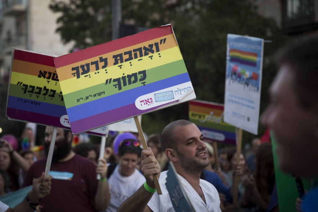 Thousands of people march during the annual Gay Pride parade in Jerusalem, September 18, 2014. Photo: Hadas Parush / Flash90
