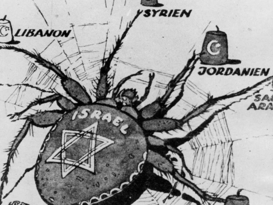 An anti-Semitic and anti-Israel political cartoon, accusing Israel of controlling the Middle East.  The cartoon, from Germany, is drawn along the lines of the anti-Semitic cartoons published in the Nazi periodical Der Sturmer. Photo: Infocenters