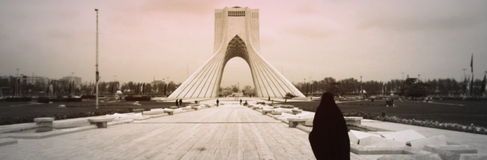 A woman walks near the Azadi Tower in Tehran. Photo: Morteza Bahmani / flickr