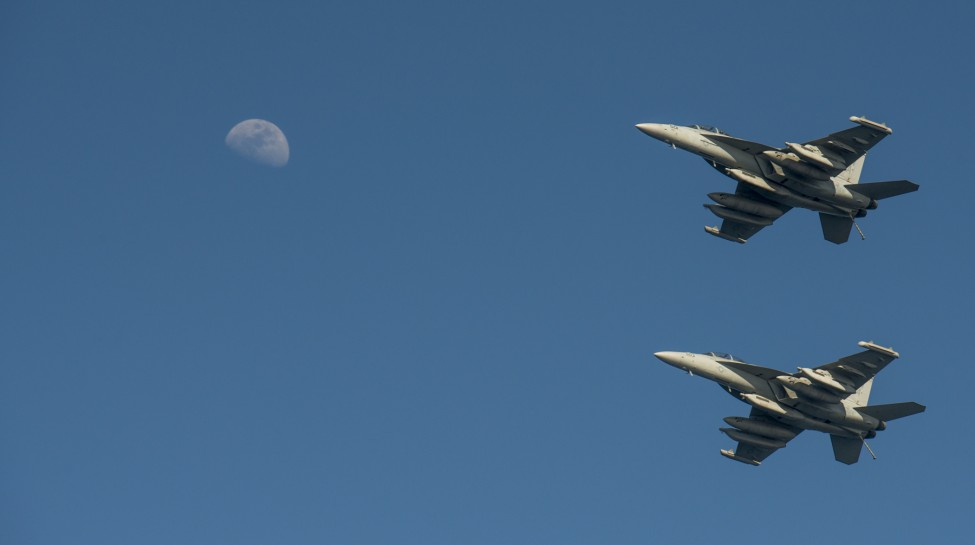 Two EA-18G Growlers fly in formation above the U.S. Navy aircraft carrier USS Carl Vinson, February 27, 2015. Carl Vinson is deployed in the U.S. 5th Fleet area of operations supporting Operation Inherent Resolve, which conducts airstrikes against ISIS targets in Iraq and Syria. Photo: MCS 2nd Class John Philip Wagner, Jr. / U.S. Navy / flickr