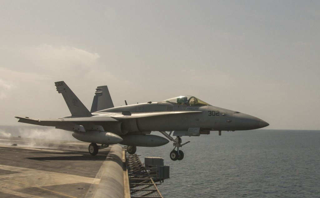 An F/A-18C Super Hornet launches from the U.S. Navy aircraft carrier USS Carl Vinson, March 3, 2015. Carl Vinson is deployed in the U.S. 5th Fleet area of operations supporting Operation Inherent Resolve, which conducts airstrikes against ISIS targets in Iraq and Syria. Photo: MCS 2nd Class John Philip Wagner, Jr. / U.S. Navy / flickr