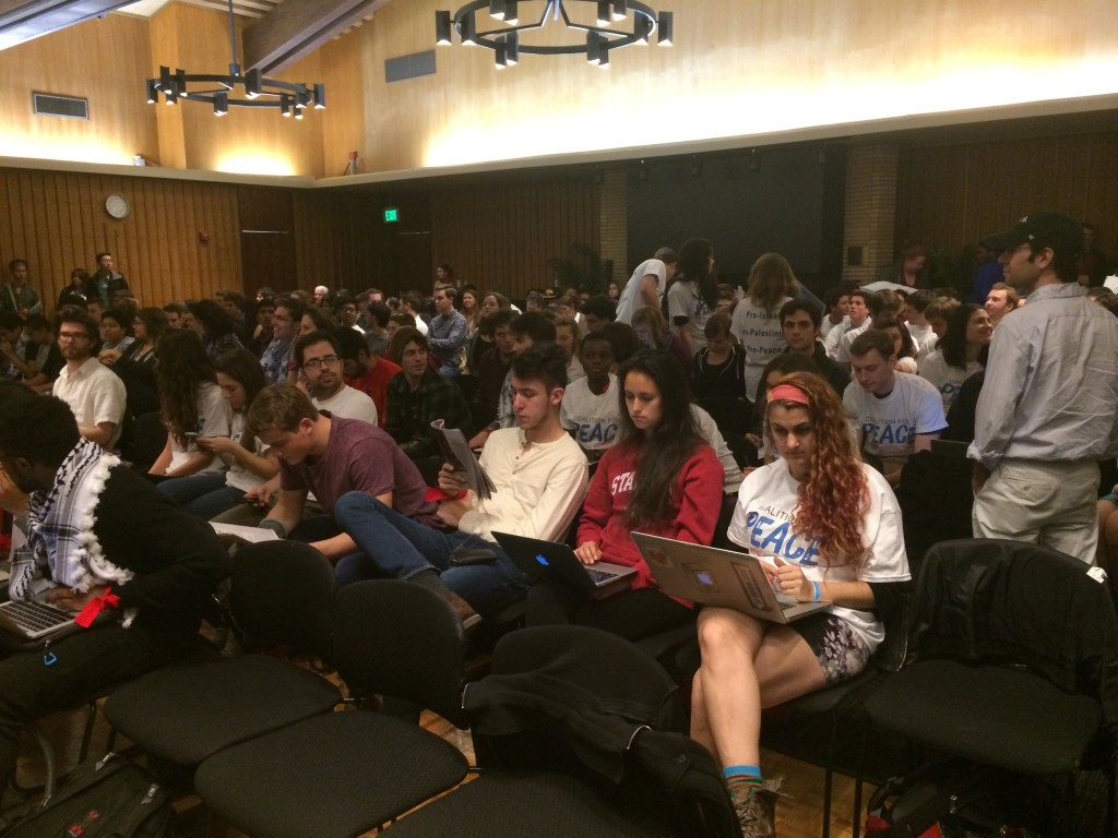 Students from the Stanford Coalition for Peace sit near the back of the hearing room during the Undergraduate Senate's first debate on divestment. Photo: Miriam Pollock / The Tower