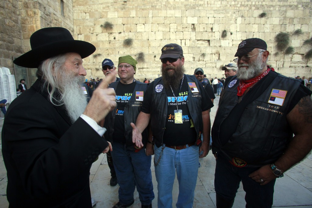 Participants of a delegation of Evangelical motorcyclists from the United States arrive at the Western Wall in Jerusalem, November 6, 2011. The organization Mission M25, consisting of Evangelical pastors and military veterans, ride through Israel on a nine-day motorcade on Harley Davidson motorbikes. Photo: Uri Lenz/ Flash 90