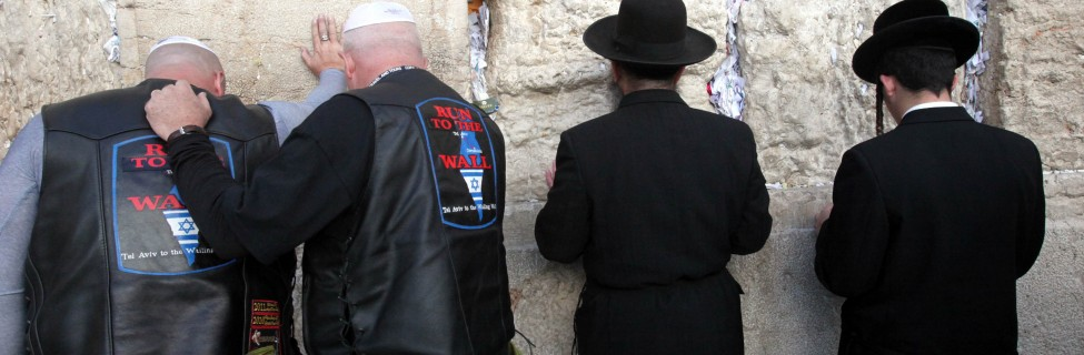 Participants of a delegation of Evangelical motorcyclists from the United States pray at the Western Wall in Jerusalem, November 6, 2011. The organization Mission M25, consisting of Evangelicalpastors and military veterans, ride through Israel on a nine-day motorcade on Harley Davidson motorbikes. Photo: Yossi Zamir / Flash 90