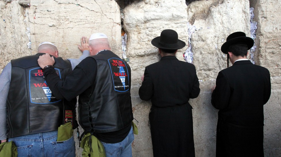Participants of a delegation of Evangelical motorcyclists from the United States pray at the Western Wall in Jerusalem, November 6, 2011. The organization Mission M25, consisting of Evangelical pastors and military veterans, ride through Israel on a nine-day motorcade on Harley Davidson motorbikes. Photo: Yossi Zamir / Flash 90