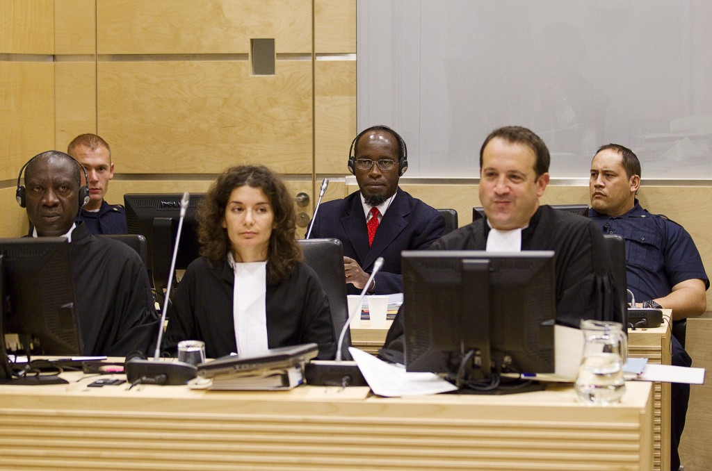 Callixte Mbarushimana is seen behind his defense team at the opening of the confirmation of charges hearings at the International Criminal Court in The Hague, September 15, 2011. Mbarushimana, a senior leader of the rebel group FDLR during the conflict in the Democratic Republic of the Congo, is charged with 11 counts of crimes against humanity and war crimes, including murder and rape. Photo: Jerry Lampen / Flash90