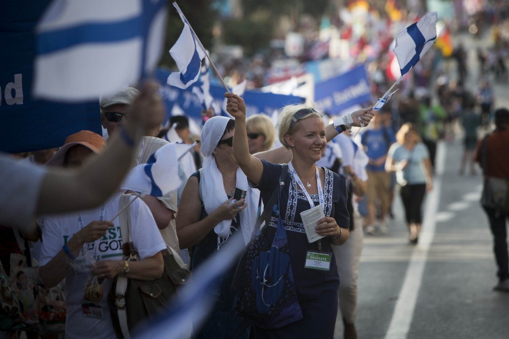An Evangelical supporter of Israel waves during the annual parade in Jerusalem, marking the Jewish holiday of Sukkot, October 4, 2012. The parade take place every year during Sukkot, with many delegations from Israel and abroad. Photo: Yonatan Sindel / Flash90