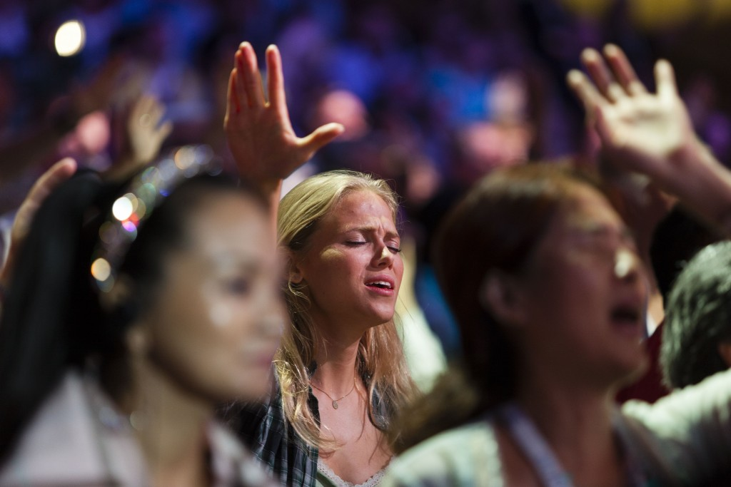 Evangelical Christians from around the world sing and recite prayers as they attend the 2013 Jerusalem Chairman's Conference hosted by the Israel Allies Foundation, at the International Convention Center in Jerusalem, on September 22, 2013. Photo: Flash90