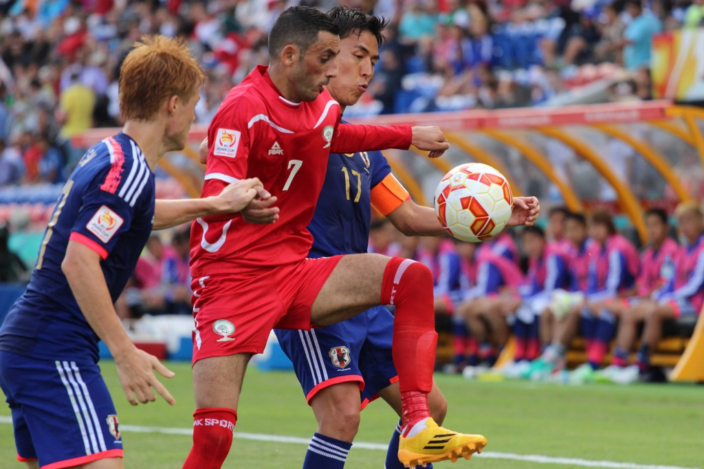 Japan takes on Palestine in a match at the 2015 Asian Cup. Photo: Nasya Bahfen / flickr