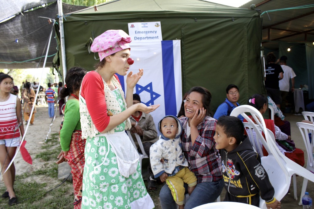 A clown entertains children at the Israeli field hospital in Nepal. Photo: Yardena Schwartz / The Tower