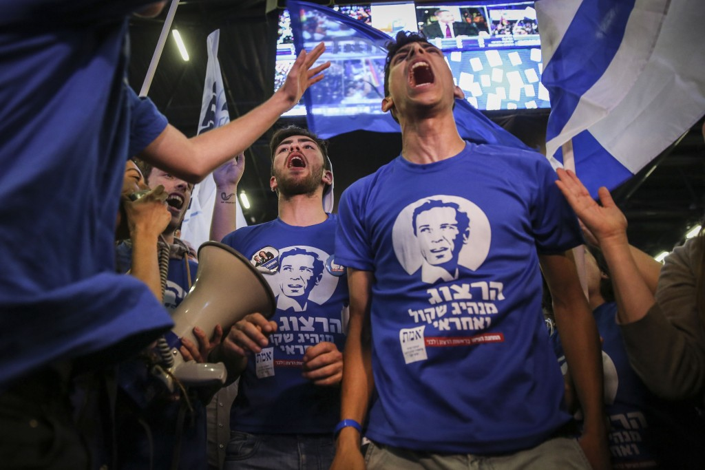 Supporters of the Zionist Union celebrate at the party's election headquarters in Tel Aviv after the exit polls in the Israeli general elections were announced, March 17, 2015. Photo: Hadas Parush / Flash90