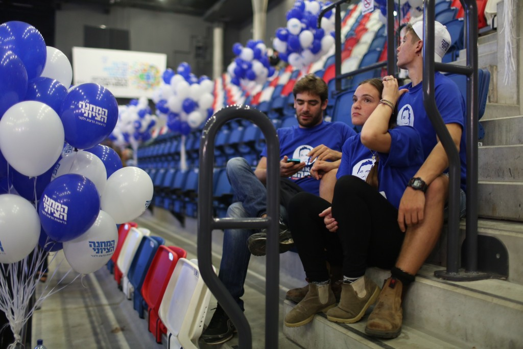 Supporters of the Zionist Union sit at the party's election headquarters in Tel Aviv after the exit polls in the Israeli general elections were announced, March 17, 2015. Photo: Hadas Parush / Flash90