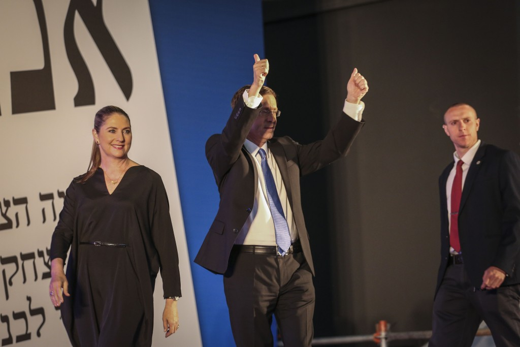 Zionist Union leader Isaac Herzog walks onto the stage with his wife at the party's election headquarters in Tel Aviv after the exit polls in the Israeli general elections were announced, March 17, 2015. Photo: Hadas Parush / Flash90