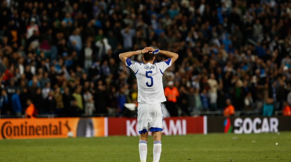 Israeli national team defender Rami Gershon reacts to his team's loss against Belgium in a European championship qualifying match March 31, 2015. Photo: Yonatan Sindel / Flash90