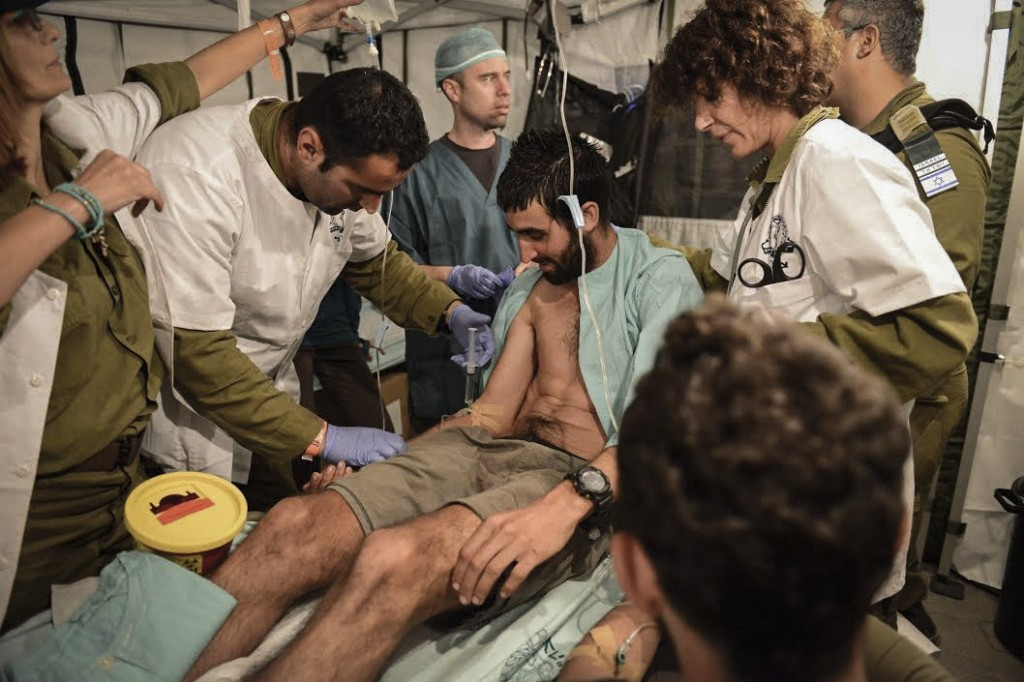 A man is treated for injuries at the Israeli field hospital in Nepal. Photo: IDF / Flash90