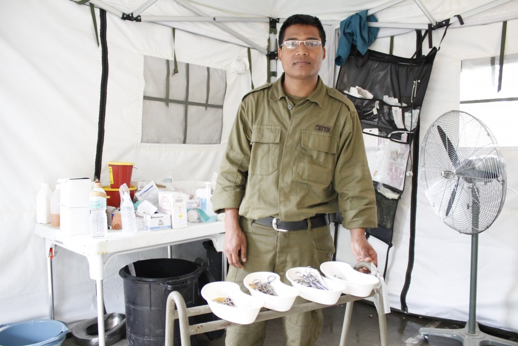 Nepali doctor Krishna Kashichawa, who is doing his residency at Hadassah Medical Center in Jerusalem, returned to Nepal for the first time in two years as part of the IDF's medical aid mission. Photo: Yardena Schwartz / The Tower