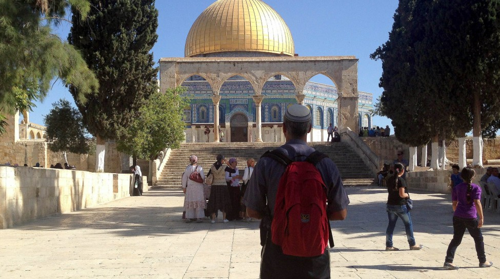 A Jewish man looks at the Dome of the Rock atop the Temple Mount. Photo: Sliman Khader / Flash90