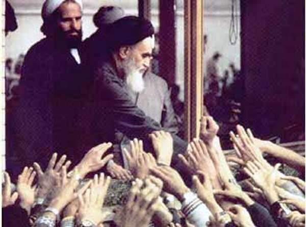 Ayatollah Ruhollah Khomeini greets followers.