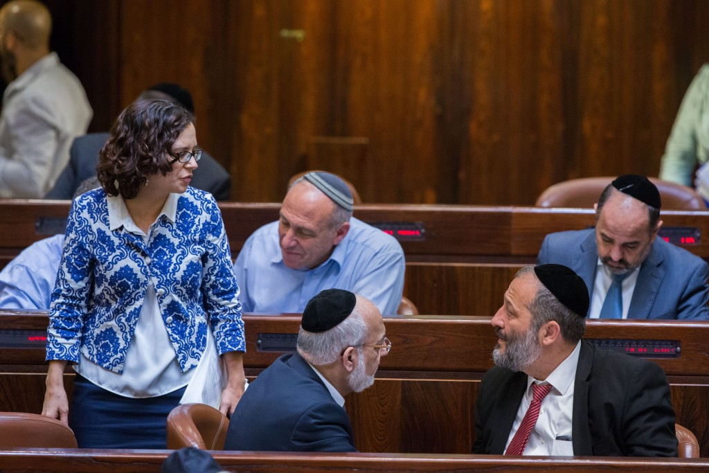 MK Rachel Azaria speaks with Economy Minister Aryeh Deri during a Knesset plenum session, July 15, 2015. Photo: Yonatan Sindel / Flash90