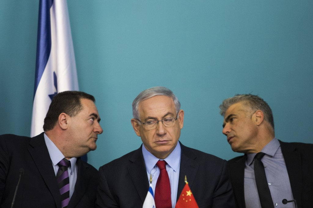 From left: Israeli Minister of Transportation Yisrael Katz, Prime Minister Benjamin Netanyahu, and Minister of Finance Yair Lapid  attend a signing ceremony at the Prime Minister's office in Jerusalem along with Chinese Ambassador to Israel Gao Yanping and Ashdod mayor Yechiel Lasri (both not seen) on September 23, 2014. After three months of negotiations, Israel and the China Harbor Engineering Company have reached terms for the Beijing firm to begin construction on a private port in Ashdod. Photo: Noam Revkin Fenton/Flash90