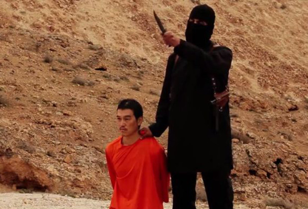 In a still from an ISIS video, Japanese journalist Kenji Goto is threatened by Jihadi John.