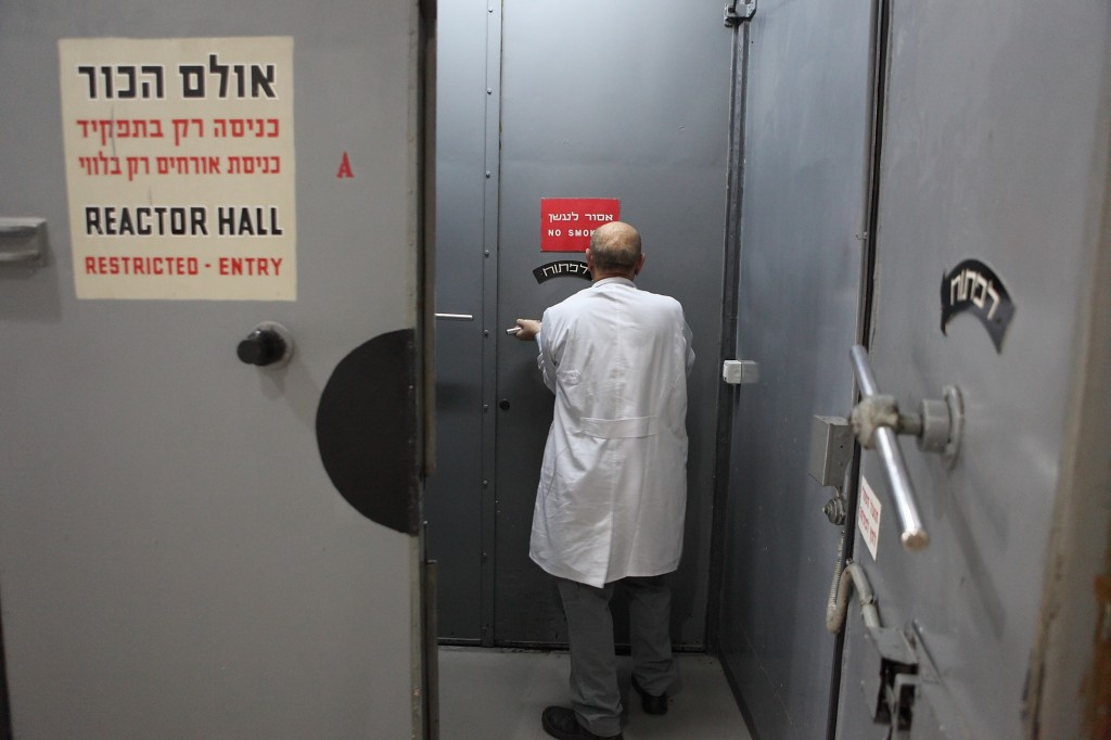 A scientist enters the reactor hall of the nuclear facility in Nahal Sorek. Unlike the nuclear reactor at Dimona, the reactor at Nahal Sorek is inspected by the International Atomic Energy Agency twice a year. Photo: Yaakov Naumi / Flash90