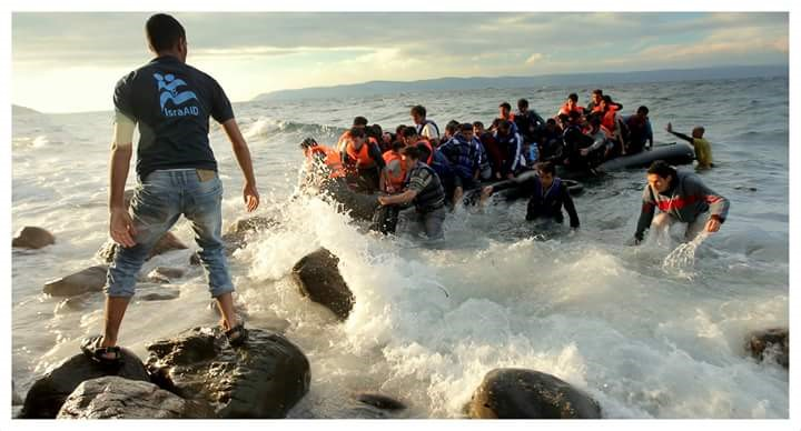 IsraAID nurse Malek Abu-Gharara brings Syrian refugees ashore. Photo: Nathan Jeffay / The Tower