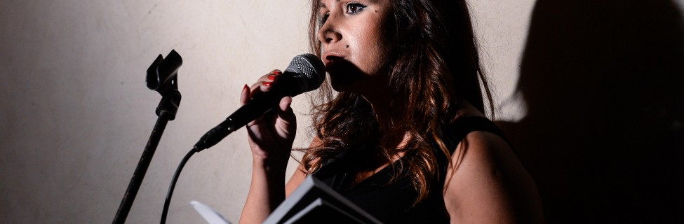 A poet shares her work at an Ars Poetica reading. Photo: Aviram Valdman / The Tower
