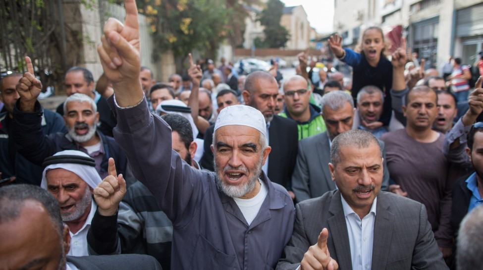 Sheikh Raed Salah, the leader of the Northern Branch of the Islamic Movement , marches with his supporters outside the Jerusalem District Court, October 27, 2015. Salah recieved a sentence of eleven months in prison for incitement to violence and racism against Jews. Photo: Yonatan Sindel / Flash90