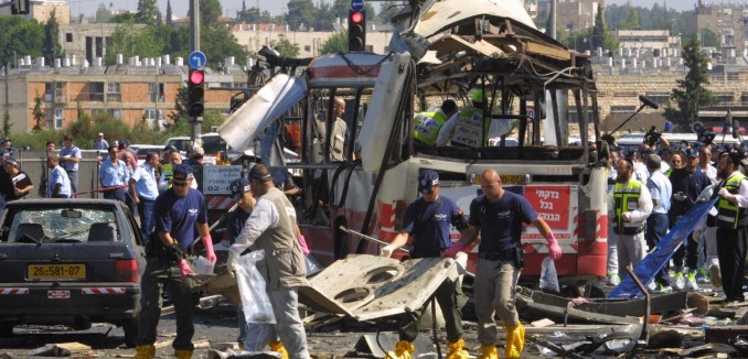 **FILE2002** Paramedics and police at the scene of a suicide bombing killing 19 and injuring 74 on a bus in Jerusalem. Hamas claimed responsibility for the attack. June 18, 2002. Photo by Flash90