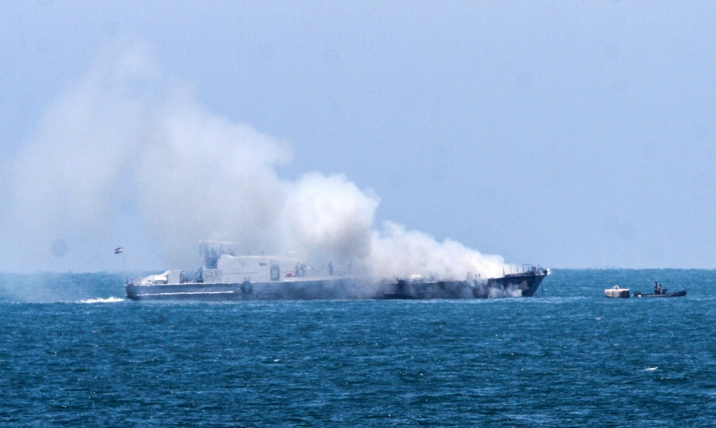 Smoke billows from an Egyptian naval vessel on the maritime border between Egypt and the Gaza Strip, July 16, 2015. The Egyptian military said that the vessel was set ablaze during a clash with militants in the Sinai Peninsula. Photo: Abed Rahim Khatib / Flash90