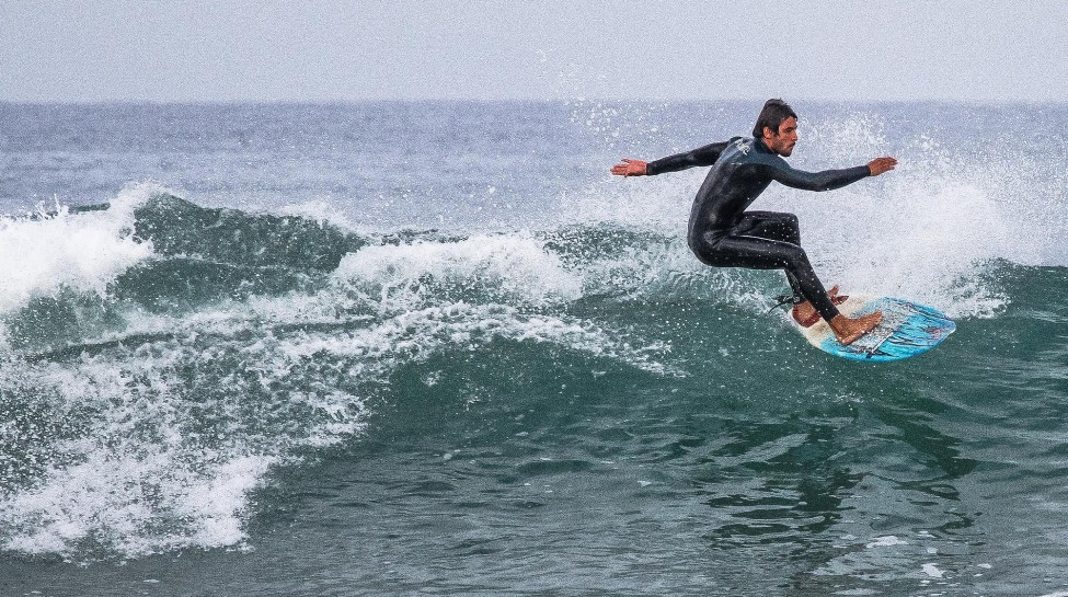 Frenchman Nicholas Klotz of Surfing 4 Peace rides the waves. Photo: Aviram Valdman / The Tower