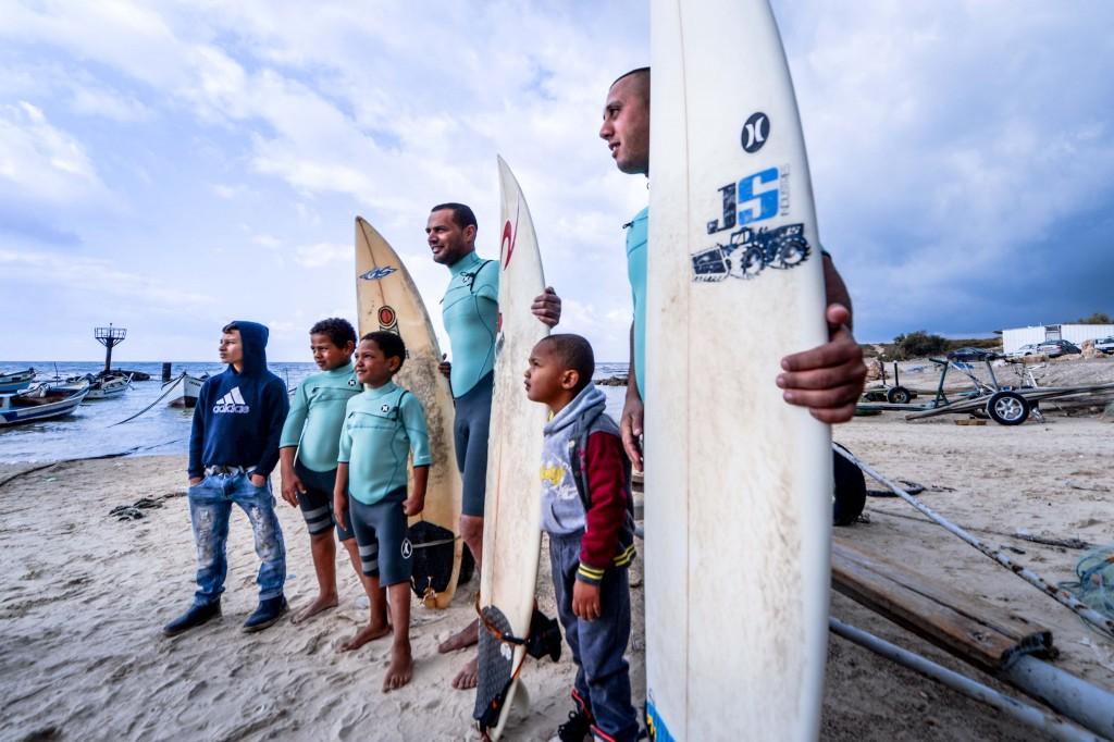 Surfers prepare to enter the water. Photo: Aviram Valdman / The Tower