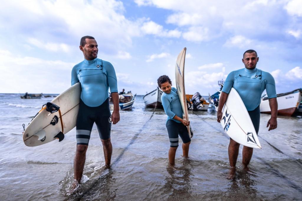 Mohamad Jurban (left) and Barak Jurban (right) prepare to surf. Photo: Aviram Valdman / The Tower