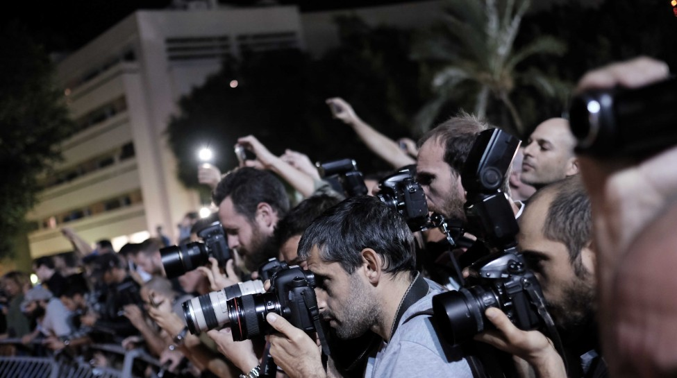 Photojournalists photograph a protest in Tel Aviv against a controversial agreement reached over the past few months between the government and large energy companies over natural gas production, November 14, 2015. Photo: Tomer Neuberg / Flash90