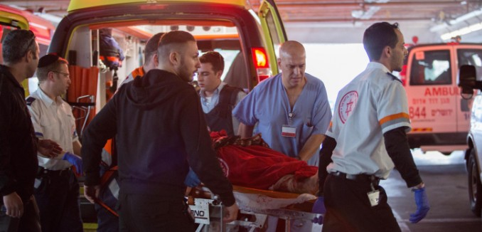 Wounded Israelis are evacuated at to emergency at Shaarei Tzedek hospital in Jerusalem, after they were wounded when a Palestinian driver rammed his car into a bus stop injuring about 13 people who were waiting there, on Herzl Boulevard at the entrance to the city, on December 14, 2015. Three of the victims were moderately wounded, one of them an infant, and the rest were lightly wounded. The attaker was shot at the scene, and an axe was found in his vehicle. Photo by Hadas Parush/Flash90 *** Local Caption *** ??????? ????? ???? ????? ???? ??????? ????? ??? ??? ??????? ???? ?????? ??????? ?????? ????? ???? ??? ????