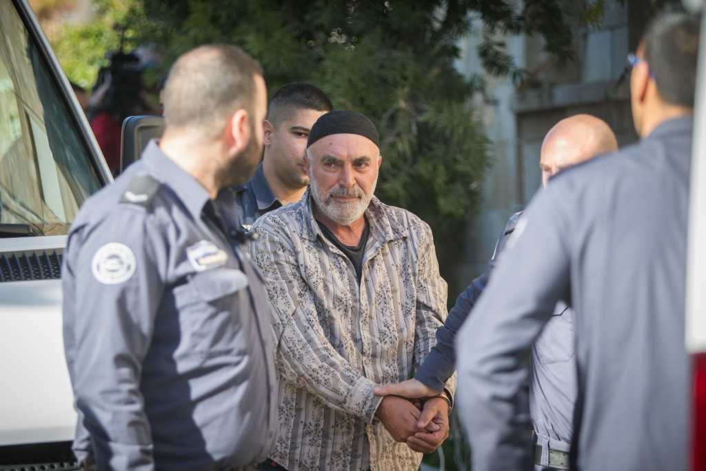 Left-wing Israeli activist Ezra Nawi, surrounded by Israeli prison guards, arrives at the Jerusalem Magistrate's Court, January 12, 2015. Nawi was arrested at Ben-Gurion airport as he tried to leave the country. He is accused of conspiracy to commit a crime. Photo: Yonatan Sindel / Flash90