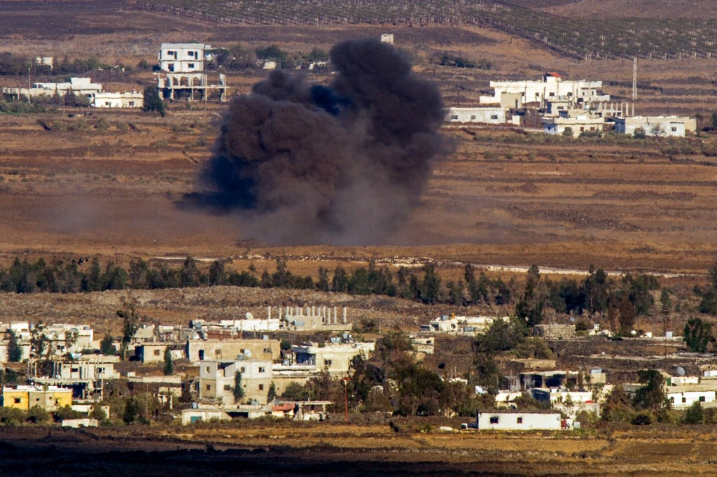 Smoke rises from a Syria village near the border with Israel, as seen from the Golan Heights, September 8, 2014. Photo: Flash90