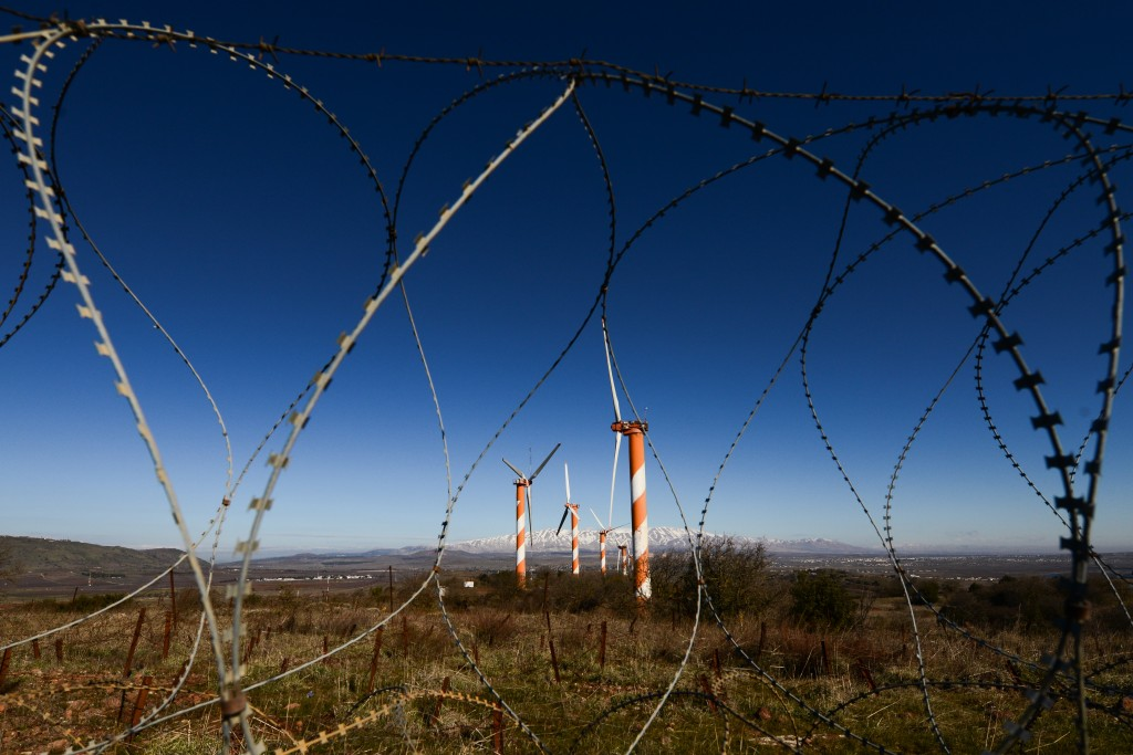 Windmills seen through barbed wire in northern Israel near the Syrian border, February 3, 2016. Photo: Mendy Hechtman / Flash90