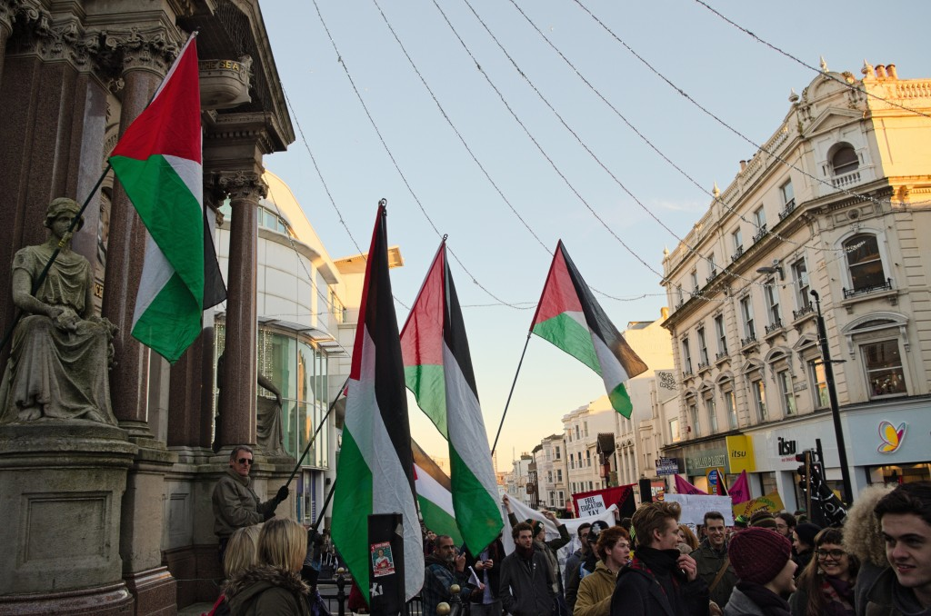 Palestinian flags fly at the March for Free Education in Brighton, UK, June 2014. Photo: Daniel Hadley / flickr
