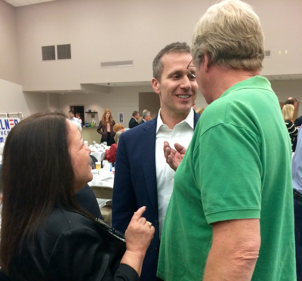 Eric Greitens speaks with voters, including Roberta Brouk (left), vice chair of the Franklin County Republican Central Committee and winner of the Franklin County Republican Activist of the Year award. Photo: Miriam Pollock / The Tower
