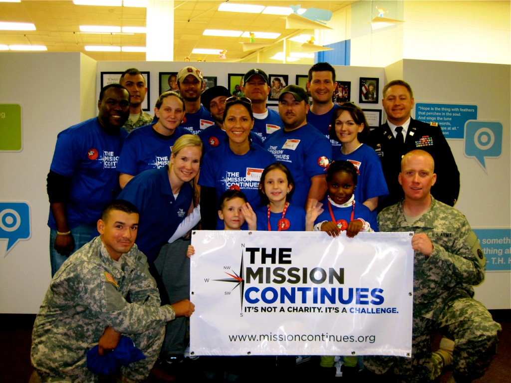Veterans and supporters with The Mission Continues, the nonprofit founded by Eric Greitens, pose after a service project in Norfolk, Va. Photo: Emily Rodenbeck / Wikimedia