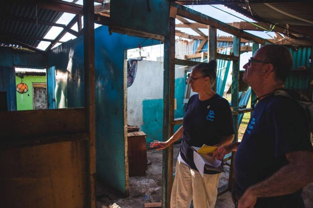 IsraAID volunteers assessing damage to a structure in Fiji.
