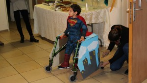 Design students helped six-year-old Brian become Superman for the day. Photo courtesy of Beit Issie Shapiro.