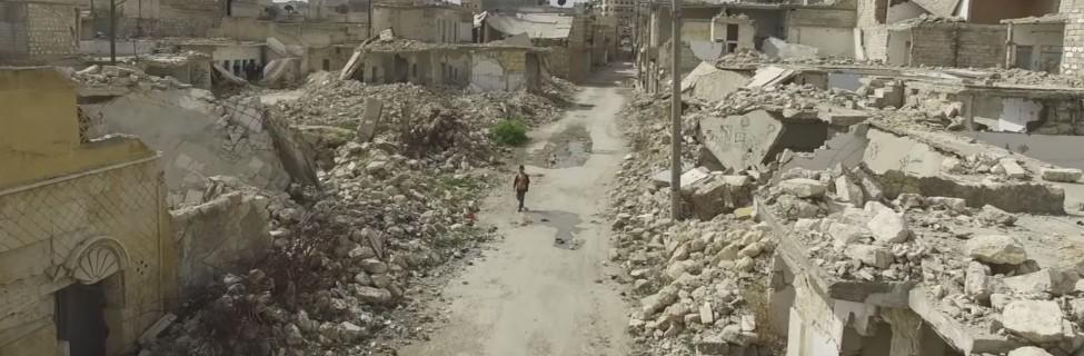 A boy walks through the ruins of Aleppo. Photo: BBC News / YouTube
