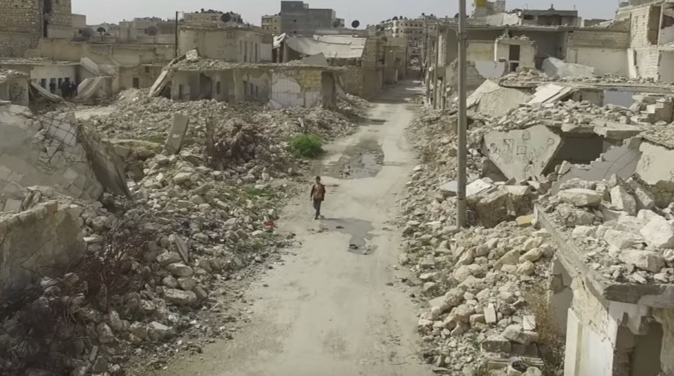 A boy walks through the ruins of Aleppo. Photo: BBC News / YouTube