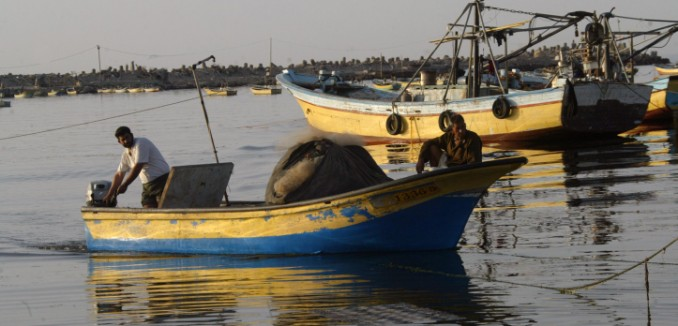 Palestinian fishermen are seen off the coast in the port of Gaza City on March 25, 2008. The start of the fishing season starts off with the owners of boats without fuel due to the embargo by Israel. Without fuel, the boats remain beached or moored adding to a food shortage. Photo by Abed Rahim Khatib /Flash90 *** Local Caption *** ??? ????? ??? ???? ?????? ?? ???????  ???????? ????????? ??????? ???????? ???????? ????????? ??????? ???????? ??????? ???????? ??????? ???????? ???????? ????????? ???????? ????????? ???????? ????????? ???????? ??????? ???????? ??????? ????????? ????????