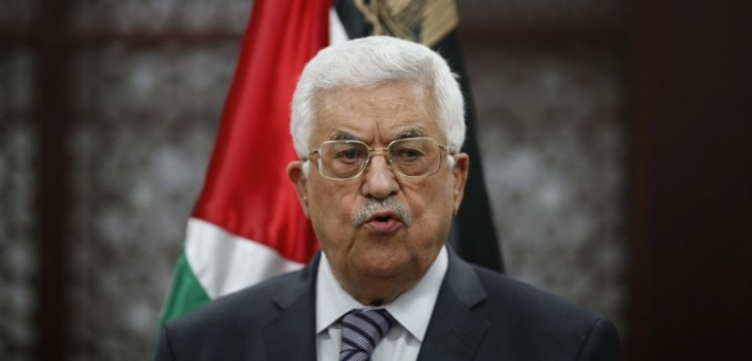 Palestinian president Mahmud Abbas speaks during a press conference in the West Bank city of Ramallah on July 31, 2015, following an arson attack by Jewish extremists that killed a Palestinian toddler. Abbas said he would appeal to the International Criminal Court (ICC) in The Hague to investigate the attack. Photo by FLASH90 *** Local Caption *** ????? ???? ??? ????