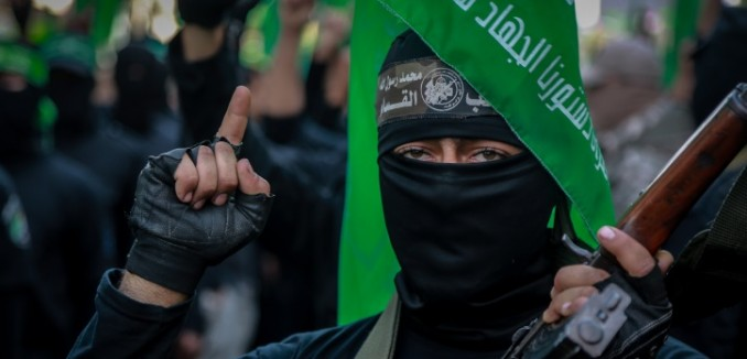 Palestinian Hamas supporters gather during a rally to commemorate the 28th anniversary of the Hamas militant group, at the main road in Gaza City. December 14, 2015  Photo by Emad Nassar/FLASH90 *** Local Caption *** ???? ???????? ???????? ??????? ???